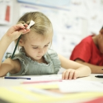 Young girl learning French at La Maternelle